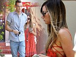 Hanging loose! Ashley Tisdale is this-close to side boob action in orange dress as she steps out with rocker beau