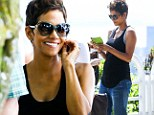 Baby bump: The 46-year-old actress Halle Berry sported a slight baby bump while sight-seeing in Rio de Janeiro on Friday after attending the premiere of her new thriller The Call