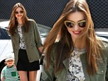 Me worried? Radiant Miranda Kerr defies Victoria's Secret sacking rumours as she treats son Flynn to play day