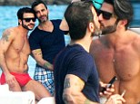 The ultimate accessory! Marc Jacobs, 50, and his muscle-bound boyfriend Harry Louis, 24, lock lips during romantic trip