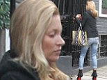 Kate Moss, 39, looks as fresh-faced as ever as she goes make-up free to visit a friend