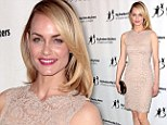 Sheer elegance! Amber Valletta radiates warmth in flesh-toned lacy frock to attend charity event
