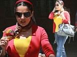 Va va voom! Salma Hayek can¿t hide her curves in a skin-tight cardigan