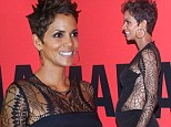 Maternity where? Pregnant Halle Berry slinks down the red carpet in Rio sporting tight satin and lace