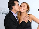 Thanks again for that IRS loan! Lindsay Lohan received a tender kiss on the cheek from her Scary Movie 5 and Anger Management co-star Charlie Sheen at the horror-spoof's premiere in Hollywood Thursday