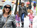 Making a splash! Sarah Jessica Parker strolls in the spring rain with her twin daughters