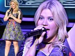 No missing her: Kelly Clarkson donned a unusual neon accented dress for her performance on America Idol on Thursday night