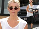 Newly single Julianne Hough shows Ryan what he's missing as she hits the gym in sheer tank top and fluorescent sports bra
