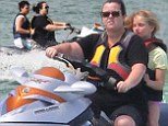 Let's zoom! Rosie O'Donnell takes her children for a ride on jet ski holiday