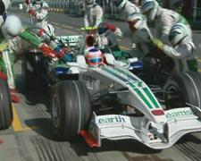 Barrichello moves off with the fuel rig still attached