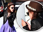 Pictured: Wild child Tallulah Willis, 19, smokes suspicious-looking cigarette behind dumpster at Coachella