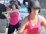 All star: Kendra Wilkinson bats, pitches and plays outfield for her softball team Saturday in Calabasas