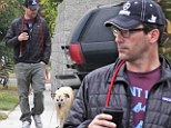 Mad Men star Jon Hamm takes his adopted dog Cora out for a walk on Saturday in the Los Feliz area of Los Angeles