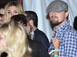 Enter the dragon: All seemed normal as Leonardo DiCaprio chatted with some ladies at Coachella on Friday night
