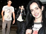 Someone to cuddle with! Krysten Ritter was spotted leaving the ArcLight Theatre in Hollywood, California with an unidentified male late Friday night