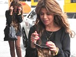 Paula Abdul dons gigantic sunglasses for trip to the airport
