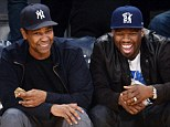 Boys day out: Denzel Washington and 50 Cent watch the Los Angeles Lakers v Golden State Warriors at the Staples Center, Los Angeles