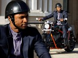 Thrill seeker: Usher zipped around the sunny streets of Beverly Hills on his custom motorbike, on Friday