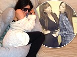 'Look who stole my pregnancy pillow': Kylie Jenner snuggles sister Kim Kardashian's maternity aid