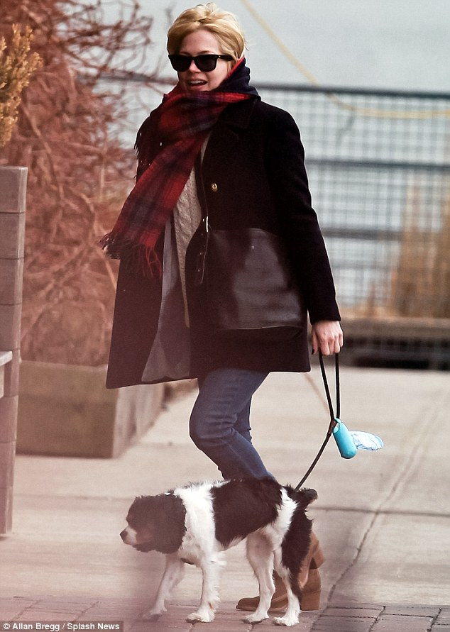 Walk the dog: Michelle was also beaming as she walked her dog earlier in the week