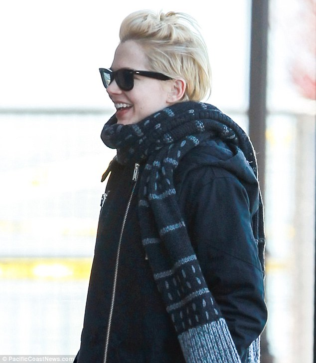 Smiling star: Bundled up from the cold, the My Week With Marilyn star was in good spirits, grinning from ear-to-ear