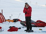 Prince Harry takes down his tent as he joins the Walking with the Wounded