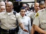 Kim Kardashian leaves court flanked by TEN sheriffs... as furious judge blast Kris Humphries over no-show