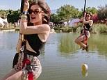 Pretty little flier! Lucy Hale reveals a daring side as she ziplines across Coachella desert in crop top and maxi skirt