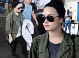 A dressed-down Demi Lovato arrived in Barbados Saturday morning, a day before her scheduled concert
