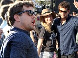 Dancing king Joshua Jackson shows off some spirited moves as he takes in Coachella performance with girlfriend Diane Kruger