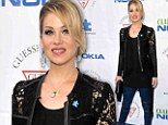 Light it up blue! Christina Applegate sizzles in lace and blue leather trousers as she walks the carpet for Autism awareness