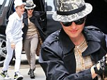 Time for enlightenment! Madonna dons trilby hat and riding trousers as she and her spirited brood descend on Kabbalah Centre