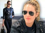 Candice Swanpoel proved she's still just an ordinary girl as she sat around awaiting her luggage in New York early on Saturday morning.