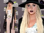 When Gothic goes wrong... Ke$ha leads worst-dressed in bizarre lace trousers and fringed jacket at the MTV Movie Awards