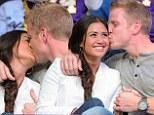 Who needs the basketball! Sean Lowe kisses fiancee Catherine Giudici as they watch the LA Lakers