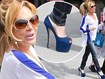 Adrienne Maloof saunters in comically high blue heels as she treats her twin sons to fast food on their birthday
