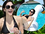 Katherine McPhee dons a bikini to a Coachella pool party and relaxes on a duck float