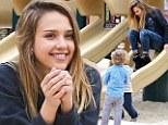 Jessica Alba spotted enjoying a child's playground slide on Saturday