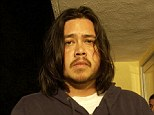 Deftones bassist Chi Cheng, at a photo session to promote the Warner Bros. Record Metal band's new Spring album release in 2003 - The musician sadly died on Saturday aged 42