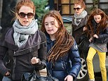 Spitting image! Julianne Moore and lookalike daughter Liv wrap up warm as they enjoy a New York stroll