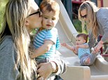 Molly Sims and her nine-months old son, Brooks, enjoy some carefree mother-son time at a local park in Los Angeles