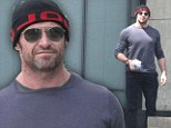 Brave face: Hugh Jackman made his way out into the streets of New York just one day after his bizarre run-in with a stalker, on Sunday