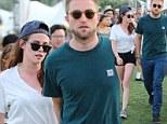 Loved up: Kristen Stewart and Robert Pattinson