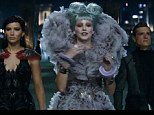 A symbol of bravery: Katniss has become a source of bravery in District 11 but in District 12 a sense of unease prevails