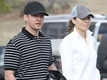 The couple that putts together... Justin Timberlake enjoys a rare day off on the golf course with wife Jessica Biel