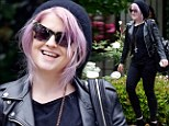 Kelly Osbourne puts on a brave face as she leaves Ozzy's house after it emerges he's 'split from Sharon'