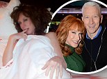 Looks like she's at it again! Kathy Griffin gets pal Anderson Cooper into trouble as she poses in his bed wearing only a white sheet