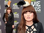 Butt of the jokes: Hana Mae Lee wore a bizarre cigarette hat as she arrived to the 2013 MTV Movie Awards at Sony Pictures Studios in Culver City, California on Sunday