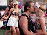 Young love! Ireland Baldwin and her paddle surfer beau Slater Trout only have eyes for each other as they steal a kiss at Coachella
