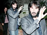 Well, he got the top half right! Keanu Reeves pairs spiffy jacket with faded jeans and stained shoes on dinner date